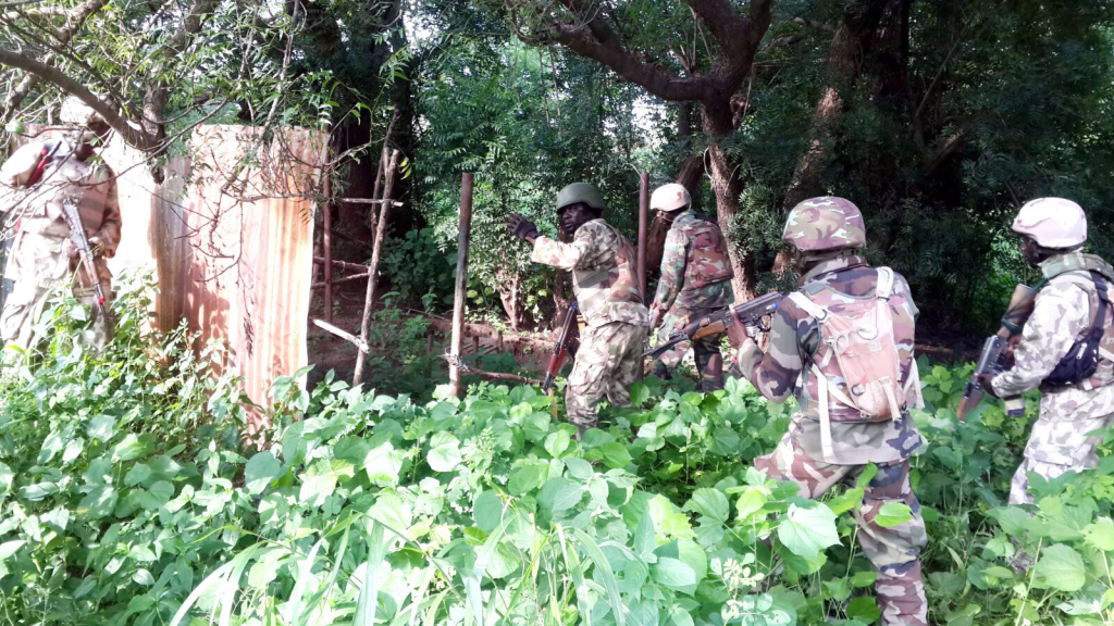 Nigerian troops 'rescue 157 captives as 77 Boko Haram members surrender'
