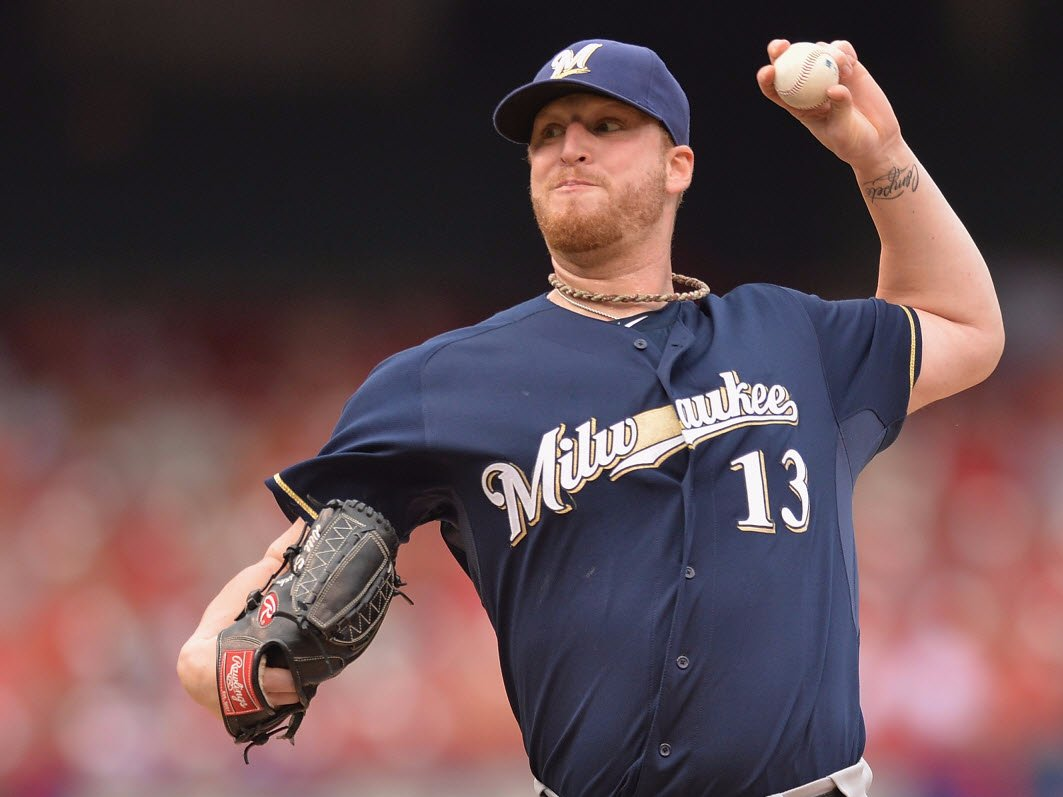 Milwaukee Brewers closer tore a ligament in his knee taking a shoe off